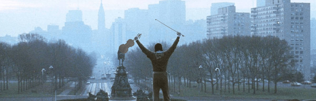 Rocky holds violin at top of Art Institute steps