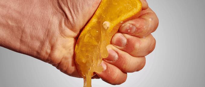 hand squeezing orange